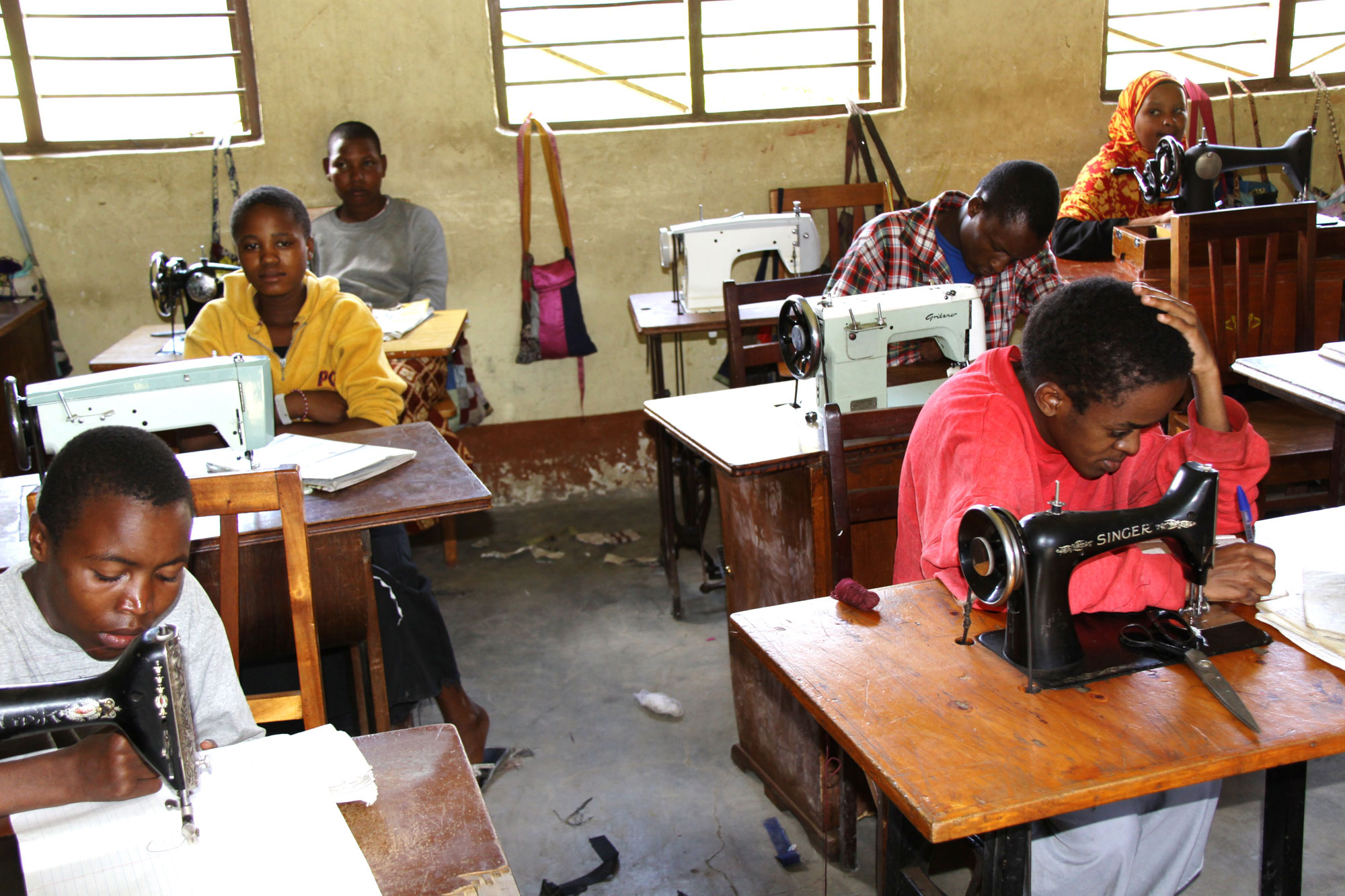 Travel Medicine - Father Pat's school for the disabled – students learning to sew.